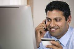 Homem de negócios a multitarefas Fotos de Stock