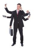 Homem de negócios a multitarefas Fotos de Stock Royalty Free
