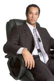 Homem de negócios na cadeira imagens de stock royalty free