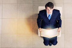 Homem de negócios na cadeira Fotos de Stock
