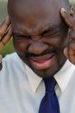 Homem de negócios na dor Fotos de Stock Royalty Free