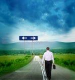 Homem de negócios na estrada Imagem de Stock