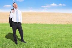 Homem de negócios na grama Fotografia de Stock