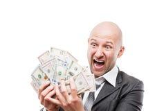 Homem de negócios na mão preta do terno que guarda o dinheiro da moeda do dólar americano Fotos de Stock