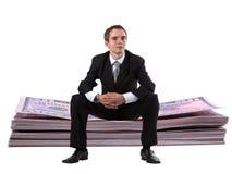 Homem de negócios na pilha do dólar Fotos de Stock Royalty Free