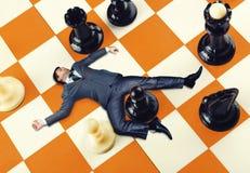 Homem de negócios na placa de xadrez Foto de Stock