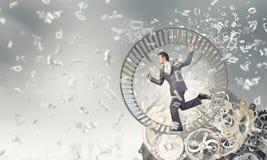 Homem de negócios na roda imagens de stock