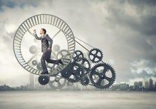 Homem de negócios na roda Foto de Stock