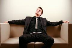 Homem de negócios na sala de estar Imagem de Stock