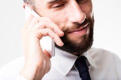 Homem de negócios na sua discussão móvel Imagem de Stock Royalty Free