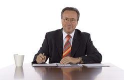 Homem de negócios na tabela Imagem de Stock Royalty Free