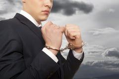 Homem de negócios nas algemas Foto de Stock Royalty Free