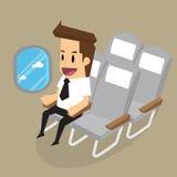 Homem de negócios no avião que olha fora Fotos de Stock