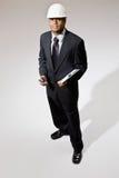 Homem de negócios no capacete de segurança com Walkietalkie Fotografia de Stock Royalty Free