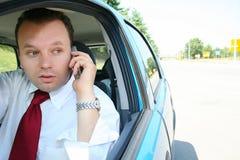 Homem de negócios no carro Fotos de Stock Royalty Free