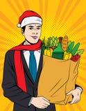 Homem de negócios no chapéu vermelho de Santa Claus que faz compras na mercearia Imagem de Stock