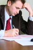 Homem de negócios no escritório Fotos de Stock