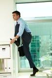 Homem de negócios no escritório Imagem de Stock