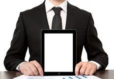 Homem de negócios no escritório que guardara a tabuleta com tela isolada fotografia de stock