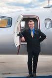 Homem de negócios no jato corporativo Foto de Stock Royalty Free