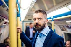 Homem de negócios no metro Fotos de Stock Royalty Free