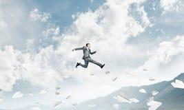 Homem de negócios no movimento Foto de Stock Royalty Free