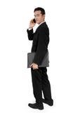 Homem de negócios no telefone, cara de giro para trás fotografia de stock royalty free