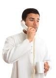Homem de negócios no telefone com café Fotografia de Stock Royalty Free