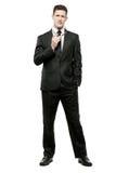 Homem de negócios no terno preto no branco. foto de stock