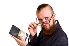 Homem de negócios nos vidros que mantêm dólares isolados no branco Foto de Stock