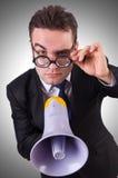 Homem de negócios novo com altifalante Imagens de Stock Royalty Free