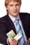 Homem de negócios novo com dinheiro Imagem de Stock Royalty Free