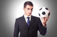 Homem de negócios novo com futebol Fotografia de Stock