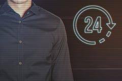 Homem de negócios novo com 24 horas de ícone Fotos de Stock Royalty Free