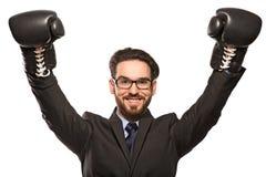 Homem de negócios novo com luvas de encaixotamento Foto de Stock Royalty Free