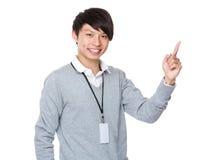 Homem de negócios novo com ponto do dedo acima Imagens de Stock