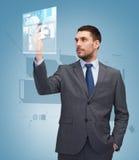 Homem de negócios novo com smartphone foto de stock