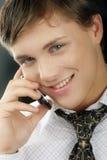 Homem de negócios novo com telefone Imagens de Stock Royalty Free