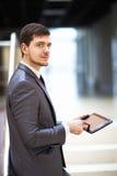 Homem de negócios novo com um PC da tabuleta Fotos de Stock Royalty Free