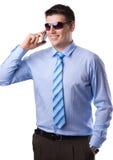 Homem de negócios novo com um telefone móvel Fotos de Stock
