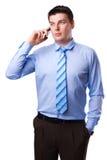 Homem de negócios novo com um telefone móvel Foto de Stock