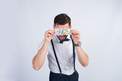 Homem de negócios novo com uma denominação de 100 dólares Foto de Stock Royalty Free