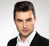 Homem de negócios novo da forma no terno preto Fotografia de Stock Royalty Free