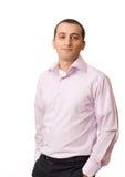 Homem de negócios novo de encontro ao fundo branco Foto de Stock