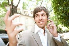Homem de negócios com grupo da orelha. Foto de Stock