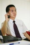 Homem de negócios novo em seu escritório Imagem de Stock