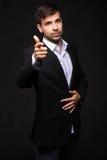 Homem de negócios novo em um terno preto Imagem de Stock Royalty Free