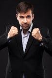 Homem de negócios novo em um terno preto Imagens de Stock