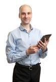 Homem de negócios novo feliz Using Digital Tablet Fotografia de Stock Royalty Free