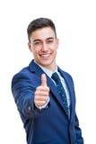 Homem de negócios novo no terno que faz os polegares acima fotos de stock